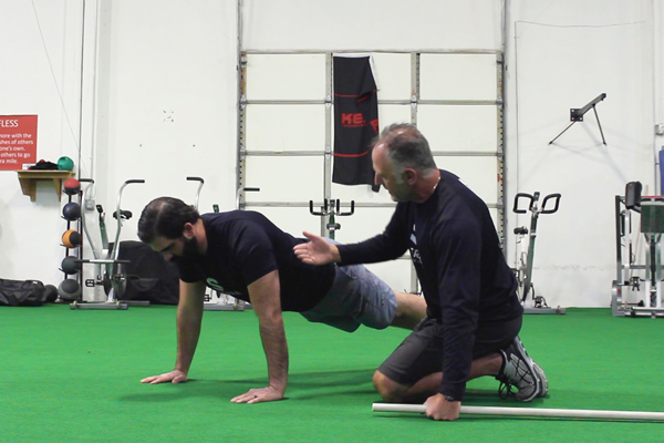 Rob Conatser and Casey Gleason demonstrate proper push-up form.